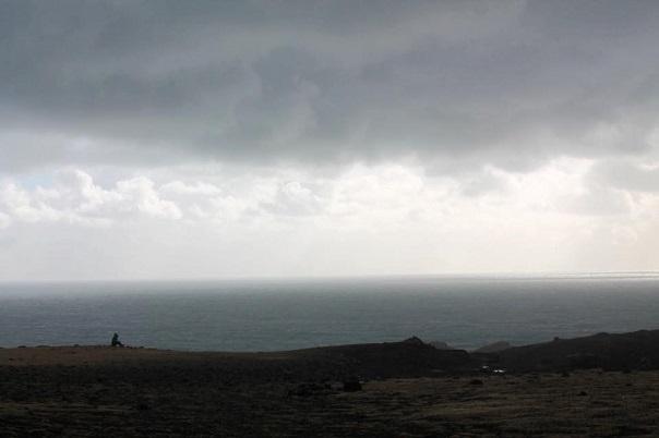 dyrholaey-cliff-iceland-person-sitting